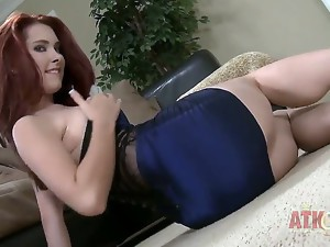 Melody Jordan is a sexy red haired temptress and she puts on a show as she crawls on