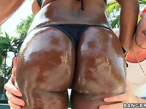 You give Jada Fire a bottle of oil and watch the magic happen! The curvy ebony babe will