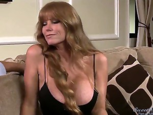 Darla Crane flirts on the couch with Manuel Ferrara.She is a super hot milf with massive boobs wearing a